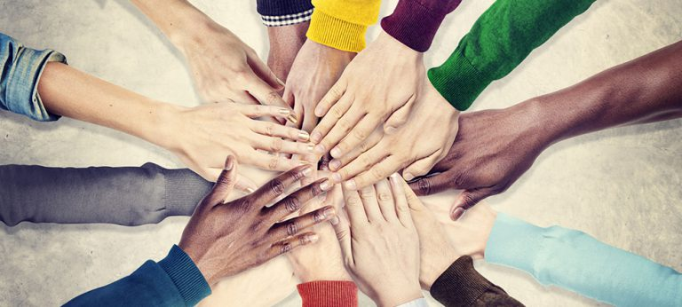 41327855 - group of human hands holding together